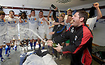St Johnstone v Morton....02.05.09.Tony Docherty and Derek McInnes spray champagne over their players in the dressing room.Picture by Graeme Hart..Copyright Perthshire Picture Agency.Tel: 01738 623350  Mobile: 07990 594431