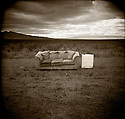 PL10812-00...IDAHO - Holga image of a couch on dirt road.