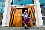 Vice Chancellor of the Bhutan University, Dasho Pema Thinley dressed in traditional Bhutanese costume (go) poses for a portrait outside his University building in Thimphu, Bhutan. Photo: Sanjit Das/Panos