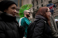 Revellers watch the parade on Fifth Avenue during the 252nd annual St. Patrick's Day Parade in New York City. Photo by Eduardo Munoz Alvarez / VIEWpress.