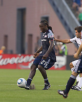 New England Revolution midfielder Shalrie Joseph (21) touch pass. The Chicago Fire defeated the New England Revolution, 1-0, at Gillette Stadium on June 27, 2010.