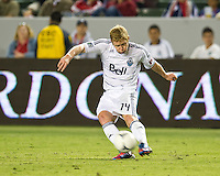 CARSON, CA - July 7, 2012: Vancouver Whitecaps Barry Robson (14) during the Chivas USA vs Vancouver Whitecaps FC match at the Home Depot Center in Carson, California. Final score Vancouver Whitecaps FC 0, Chivas USA 0.