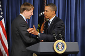 United States President Barack Obama (R) shakes hands with Richard Cordray (L) during a visit to the Consumer Financial Protection Bureau in Washington DC, USA, on 06 January 2012. Obama placed Richard Cordray as head of the Consumer Financial Protection Bureau with a recess appointment 04 January 2012. Republicans in the Senate had blocked Cordray's confirmation in December 2011..Credit: Michael Reynolds / Pool via CNP