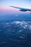 Commercial Airplane, Wing Tip, Sunset Sky, Snow capped Mountains