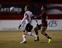 Jereme Raley (12) of Maryland looks to clear the ball away from Zeiko Lewis (19) of Boston College during the ACC tournament quarterfinals at Ludwig Field in College Park, MD.  Maryland defeated Boston College, 2-0.