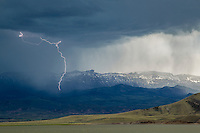 Lightning at night over Buffalo Bill Reservoir and Sheep Mountain in Northwest Wyoming