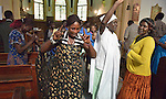 As women dance in the aisle, a children's choir sings during a worship service of Nuer refugees from South Sudan who live in Cairo, Egypt. The service took place at St Andrews United Church of Cairo.