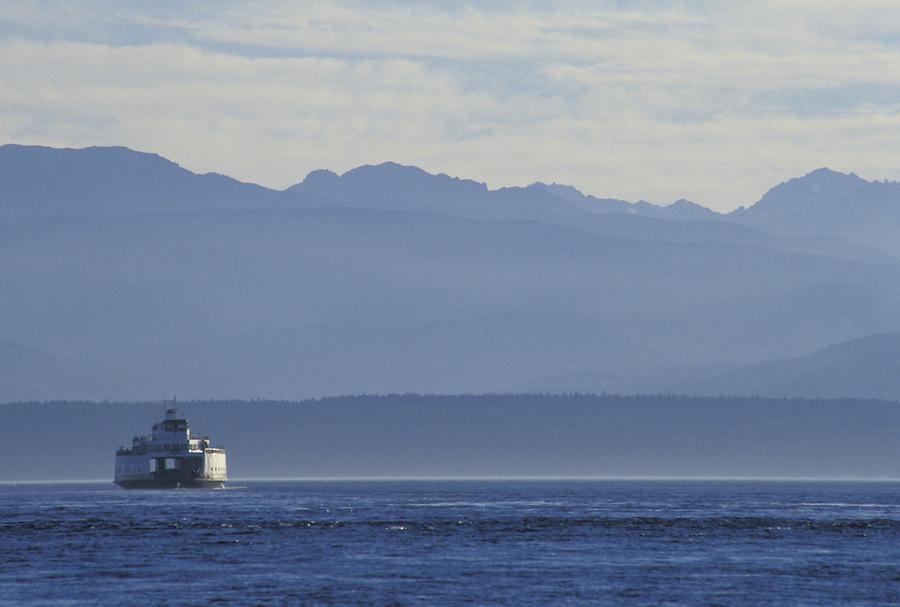 The ferry Illahee cruising the San Juan Islands (Shaw Island in background), Washington