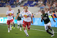Stephen Keel (22) of the New York Red Bulls and Darlington Nagbe (6) of the Portland Timbers. The New York Red Bulls defeated the Portland Timbers 2-0 during a Major League Soccer (MLS) match at Red Bull Arena in Harrison, NJ, on September 24, 2011.