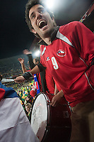 A Chile fan beats on his drum before a 2010 World Cup match against Brazil.  Chile played Brazil at Ellis Park in Johannesburg, South Africa on Monday, June 28, 2010.  Brazil defeated Chilie 3-0.