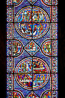 Medieval stained glass Window of the Gothic Cathedral of Chartres, France - dedicated to the Life of St Mary Magdalen. Central panel - top left - Mary meets the angel at Christ's empty tomb (the Quem quaeritis), bottom right - The Noli me tangere, top left - Mary as the Apostola Apostolorum , top right - The Apostles receiving Mary's news . Diamond below and side panels either side - Christ raising Lazarus. Bottom central panel - bottom left - Mary washing Christ's feet in the house of Simon the Pharisee, bottom right - Death of Lazarus, top left - Their neighbours try to console Mary and Martha, top right - Funeral of Lazarus. Diamond panel above and side panels either side - Christ raising Lazarus. A UNESCO World Heritage Site.