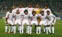 United Arab Emirates' team from left to right, back row, Ahmed Ali (9),  Abdulaziz Hussain (20), Mohamed Ahmed (19), Yousif Abdulrahman (1), Hamdan Al Kamali (8), front row, Ahmed Khalil (11), Saoud Saeed (3), Amer Abdulrahman (5), Habib Fardan (12), Sultan Al Menhali (21), Mohamed Fawzi (18), stands on the field before the match against Cost Rica during the FIFA Under 20 World Cup Quarter-final match at the Cairo International Stadium in Cairo, Egypt, on October 10, 2009.    ... ..... ..