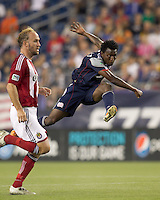 New England Revolution forward Kenny Mansally (7) follows through on a shot. In a Major League Soccer (MLS) match, Chivas USA defeated the New England Revolution, 3-2, at Gillette Stadium on August 6, 2011.