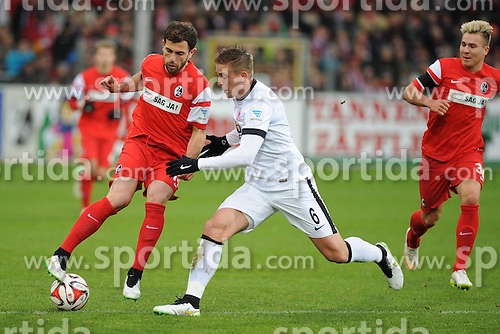 31.01.2015, Schwarzwald Stadion, Freiburg, GER, 1. FBL, SC Freiburg vs Eintracht Frankfurt, 18. Runde, im Bild (l.) Admir Mehmedi (SC Freiburg) im Zweikampf, Aktion, mit (r.) Bastian Oczipka (Eintracht Frankfurt) // during the German Bundesliga 18th round match between SC Freiburg and Eintracht Frankfurt at the Schwarzwald Stadion in Freiburg, Germany on 2015/01/31. EXPA Pictures &copy; 2015, PhotoCredit: EXPA/ Eibner-Pressefoto/ Laegler<br /> <br /> *****ATTENTION - OUT of GER*****