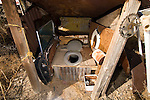 Outhouse without a door made from parts from a Volvo automobile at a ghost town in Nevada