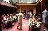 INDIA (West Bengal - Calcutta)  2006, A grand feast is organised  among the family members of  Mullick family (one of the well known families in South Calcutta) on a day of Durga Puja Festival. Durga Puja Festival is the biggest festival among bengalies.  As Calcutta is the capital of West Bengal and cultural hub of  the bengali community Durga puja is held with the maximum pomp and vigour. Ritualistic worship, food, drink, new clothes, visiting friends and relatives places and merryment is a part of it. In this festival the hindus worship a ten handed godess riding on a lion armed wth all possible deadly ancient weapons along with her 4 children (Ganesha - God for sucess, Saraswati - Goddess for arts and education, Laxmi - Goddess of wealth and prosperity, Kartikeya - The god of manly hood and beauty). Durga is symbolised as the women power in Indian Mythology.  In Calcutta people from all the religions enjoy these four days of festival in the moth of October. Now the religious festival has become the biggest cultural extravagenza of Calcutta the cultural capital of India. Artistry and craftsmanship can be seen in different sizes and shapes in form of the idol, the interior decor and as well as the pandals erected on the streets, roads and  parks.- Arindam Mukherjee