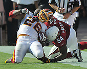 Landover, MD - September 21, 2008 -- Washington Redskins running back Clinton Portis (26) is horse collared by Arizona Cardinals middle linebacker Gerald Hayes (54) in fourth quarter action at FedEx Field in Landover, Maryland on Sunday, September 21, 2008.  The Redskins won the game 24 - 17...Credit: Ron Sachs / CNP