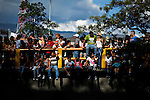 "People try to see the traditional ""Silletero"" parade during the Flower Festival in Medellin August 7, 2012. Photo by Eduardo Munoz Alvarez / VIEW."