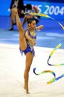 Almudena Cid of Spain balances (free leg to side) with ribbon at 2004 Athens Olympic Games during qualifications on August 29, 2006 at Athens, Greece. (Photo by Tom Theobald)