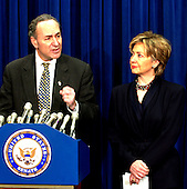 Washington, DC - February 11, 2003 -- United States  Senators Chuck Schumer (Democrat of New York), left, and Hillary Rodham Clinton (Democrat of New York), right,  announce that they have secured disaster relief funds for New York City to help the recovery from the 9/11 terrorist attacks in the U.S. Capitol in Washington, D.C. on February 11, 2003..Credit: Ron Sachs / CNP