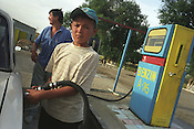 Filling up the petrol tank at a station in the Uzbek countryside, Petrol station near Bukhara, Uzbekistan.