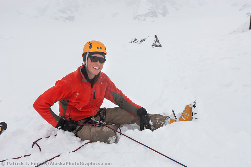 Mountaineer Mark Howell belays climber in the Alaska range mountains.