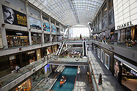 Singapore. Marina Bay Sands. The Shopping Mall. Gondolas on channels.