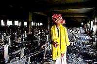 Razib is a survivor of the fire incident. He jumped from the fourth floor and had a bad injury to his waist and head. He comes to the factory to collect his salary and had not received any salary/compensation from the factory. At least 112 people died, and more than 100 were injured at a fire at the Tazreen Fashions textile factory in Dhaka. Bangladesh's garment industry has a notoriously bad fire safety record; if the right precautions had been taken, the fire could have been prevented.