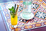 Mango Mojito with mint leaves and sugar cane