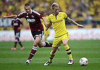 FUSSBALL   1. BUNDESLIGA  SAISON 2012/2013   2. Spieltag 1. FC Nuernberg - Borussia Dortmund       01.09.2012 Timmy Simons (li, 1 FC Nuernberg) gegen Marco Reuss (Borussia Dortmund)