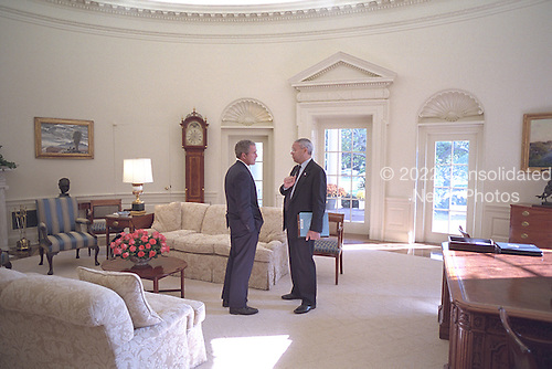 United States President George W. Bush talks privately with U.S. Secretary of State Colin Powell inside the Oval Office of the White House in Washington, D.C. on Wednesday, November 7, 2001..Mandatory Credit: Eric Draper - White House via CNP.