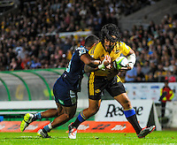 Ma'a Nonu is tackled during the Super Rugby match between the Hurricanes and Blues at FMG Stadium, Palmerston North, New Zealand on Friday, 13 March 2015. Photo: Dave Lintott / lintottphoto.co.nz
