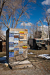 An outhouse covered with license plates created by by Chief Rolling Mountain Thunder (aka Frank Van Zant, 1921-1989) and old military ambulance at Thunder Mountain Monument park along I-80 near Imlay, Nev. The park was Van Zant's monument to the American Indian.