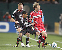 Daniel Allsopp #9  watches Andy Najar #14 of D.C. United knock the ball away from Justin Mapp #21 of the Chicago Fire during an MLS match on April 17 2010, at RFK Stadium in Washington D.C. Fire won the match 2-0.