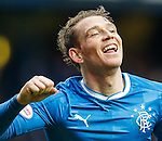 Joe Garner, with his battle scars and stitches, celebrates scoring his hat-trick