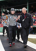 Tim Benedetto has a discussion with a Rink Specialists representative on his walk to the ice. - The Northeastern University Huskies defeated the University of Massachusetts Lowell River Hawks 4-1 (EN) on Saturday, January 11, 2014, at Fenway Park in Boston, Massachusetts.