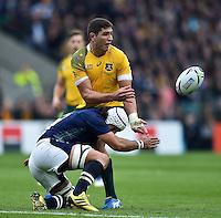 Rob Simmons of Australia offloads the ball after being tackled by Blair Cowan of Scotland. Rugby World Cup Quarter Final between Australia and Scotland on October 18, 2015 at Twickenham Stadium in London, England. Photo by: Patrick Khachfe / Onside Images