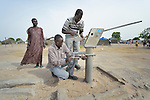 Majdi Abduharaman (right) and Abraham Thom repair the hand pump on a well in Bor, a city in South Sudan's Jonglei State that has been the scene of fierce fighting in recent months between the country's military and anti-government rebels. After fighting broke out in mid December 2013, control of the town changed hands four times in a few weeks. ACT Alliance members were among the first humanitarian agencies to enter the city in January 2014, and are providing services to thousands of people who are cautiously returning home to the troubled city. Abduharaman is an emergency specialist for Norwegian Church Aid, a member of the ACT Alliance, and Thom is a technician for the government's Department of Rural Water.