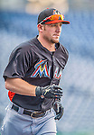 20 September 2013: Miami Marlins catcher Jeff Mathis warms up prior to a game against the Washington Nationals at Nationals Park in Washington, DC. The Nationals defeated the Marlins 8-0 to take the second game of their 4-game series. Mandatory Credit: Ed Wolfstein Photo *** RAW (NEF) Image File Available ***