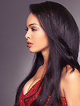 Sensual beauty portrait of a beautiful young woman profile with long black hair