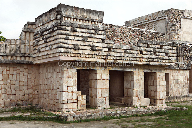 The Quadrangle of the Birds with the symbol of corn (¤) on the frieze above the doors, 900-1000 AD, Puuc architecture, Uxmal late classical Mayan site, Yucatan, Mexico. Picture by Manuel Cohen