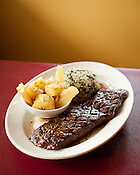 Churrasco steak, the house specialty at Oakwood Cafe in Raleigh, N.C., Wednesday, September 28, 2011. Oakwood's menu is evenly split between Cuban and Argentinean food, including the hand-cut and cooked to order steak drizzled in chimichurri sauce.