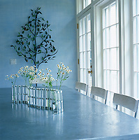 The zinc-topped table in the kitchen/dining room with an unusual vase made from test tubes