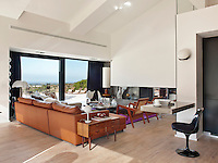 Large picture windows afford the living room the same spectacular views as the terrace
