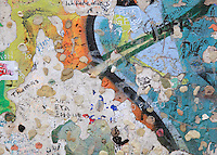 Detail of the Berlin Wall covered in graffiti in the Potsdamerplatz, Berlin, Germany. The Berlin Wall was constructed in 1961 by East Germany, the former GDR, to surround West Berlin, and was brought down in 1989. Picture by Manuel Cohen