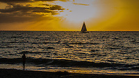Fine Art Print Photograph, Sunset in Banderas Bay, Puerto Vallarta, Mexico. Sailboat passes by the setting sun.