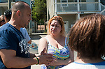 WATERBURY,  CT-051917JS02-Victor Cuevas, left, talks with Charitza Santiago, who, with her three children, lost everything in the fire on Lounsbury Street in Waterbury on Friday during a social services fair at the River Baldwin Recreation Center in Waterbury. The event, organized by the Hispanic Coalition of Greater Waterbury, to offer help and guidance families displaced from their homes following the fire on. Santiago and her family lived at 58-60 Lounsbury on the second floor and, like most families, lost everything in the fire. <br /> Jim Shannon Republican-American