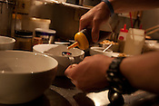 Preparing the 'tare'' (flavouring) in noodle bowls, in Bassa Nova ramen restaurant in Shindaita district, in Tokyo, Japan, Wednesday 28th April 2010.