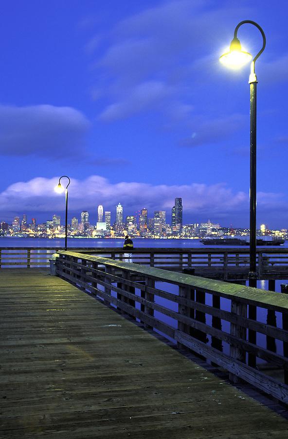 Seattle skyline and West Seattle wharf at night, Seattle, Washington