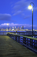 Seattle skyline and West Seattle wharf at night, Seattle, Washington